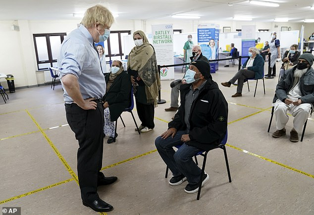 Boris Johnson has been calling on all Britons to get the Covid vaccine. He is pictured visiting a jabs centre at the Indian Muslim Welfar Society's Al-Hikmah Centre in Batley, West Yorkshire