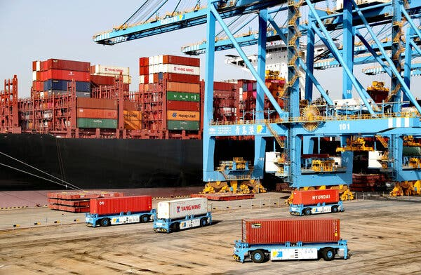 A container port in Shandong Province, China. American economic output would drop $190 billion annually if the United States imposed a 25 percent tariff on all trade with China, a new report says.