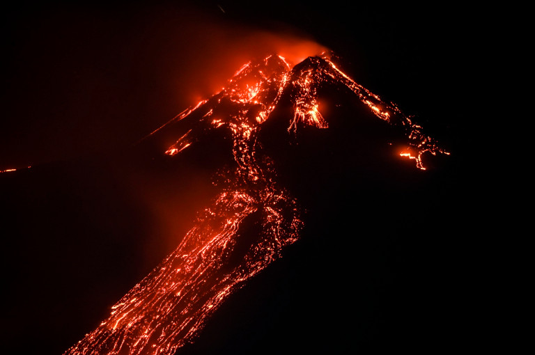 A view of the eruption of Etna seen from the port of Riposto in the province of Catania. The lava flow descended along the eastern side of the cone, heading towards the 'Valle del Bove' (Getty Images)