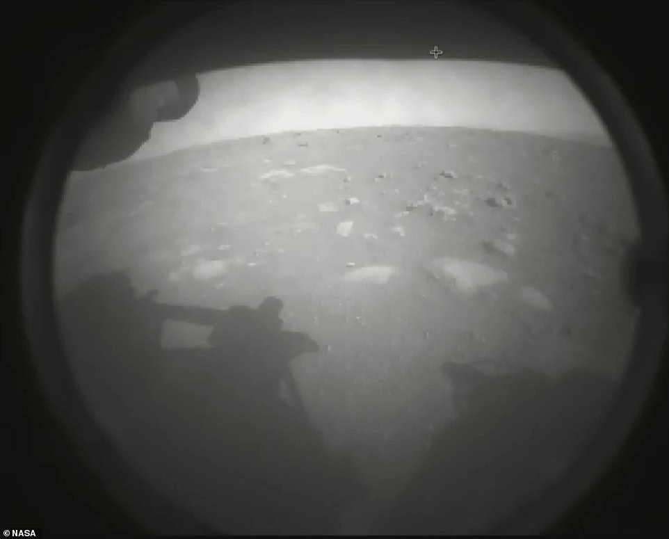 Perseverance touched down at the base of an 820ft-deep (250m) crater called Jezero, a former lake which was home to water 3.5 billion years ago. Pictured is one of the first images the rover sent back after landing on the Martian soil
