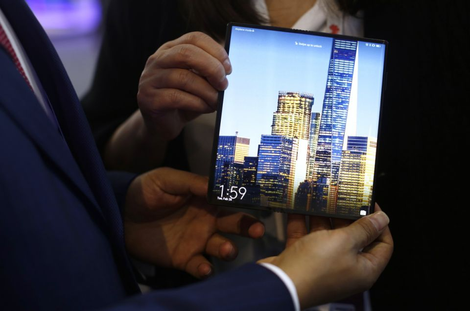 A man holds the new Huawei Mate X foldable 5G smartphone during the Mobile World Congress wireless show, in Barcelona, Spain, Tuesday, Feb. 26, 2019. The annual Mobile World Congress (MWC) runs from 25-28 February in Barcelona, where companies from all over the world gather to share new products. (AP Photo/Manu Fernandez)