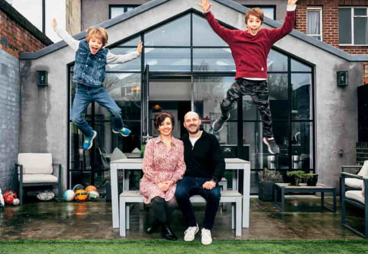 Ilona Bannister and husband sit, while sons leap