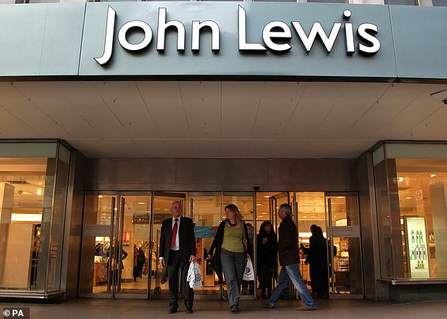 Loss: The John Lewis Partnership slumped to a £517million loss last year