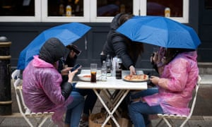 People in Cardiff City centre on Bank Holiday Monday as the rain came down and temperatures plummeted.