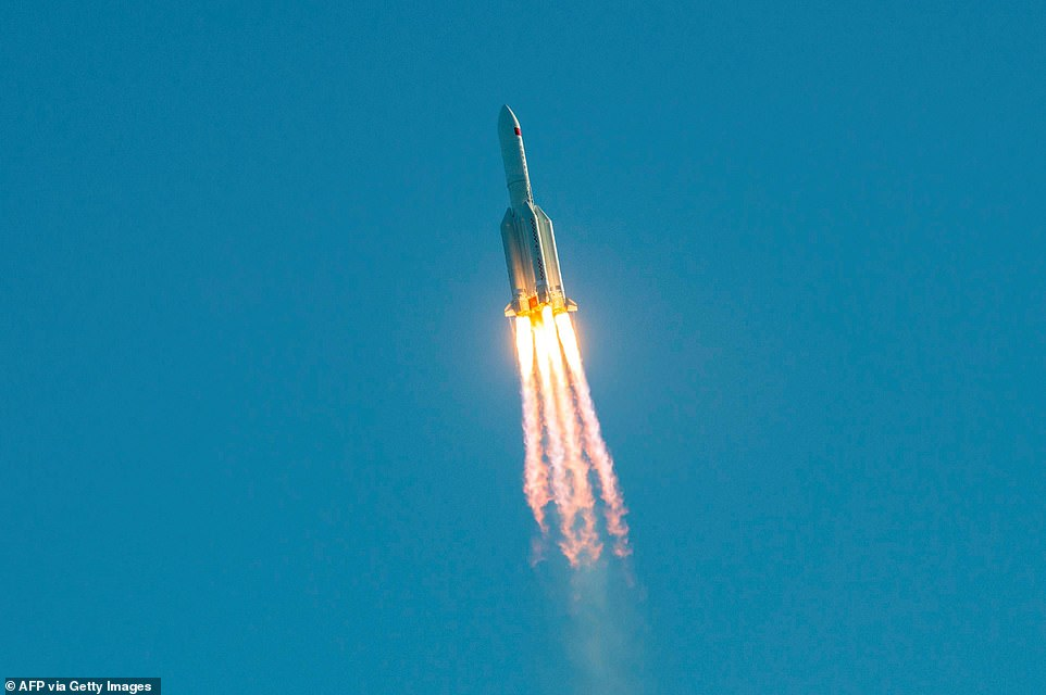 China previously launched Long March 5b in May 2020 (pictured) to test the vehicle in preparation of sending people to the moon, but this mission also ended with an uncontrolled reentry