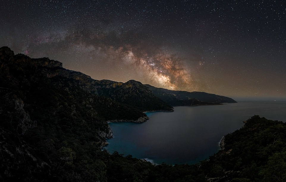 'Paradise Beach'— by Alyn Wallace in Lycian Way, Turkey. Mr Wallace said: 'I spent the pandemic in a remote valley on the southwest coast of Turkey trying to avoid the chaos of restrictions and lockdowns.Sitting on the mountainside enjoying this view of the Milky Way arching across the mountains whilst listening to the sound of the waves breaking gently below and the owls twitting through the valleys was just the kind of peace and solitude I needed'
