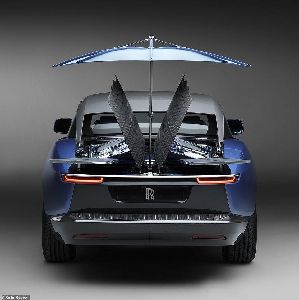 The rear deck opens like a pair of butterfly wings, providing under-cover storage for luxurious items - and two roatating cocktail tables that extend from the back of the vehicle