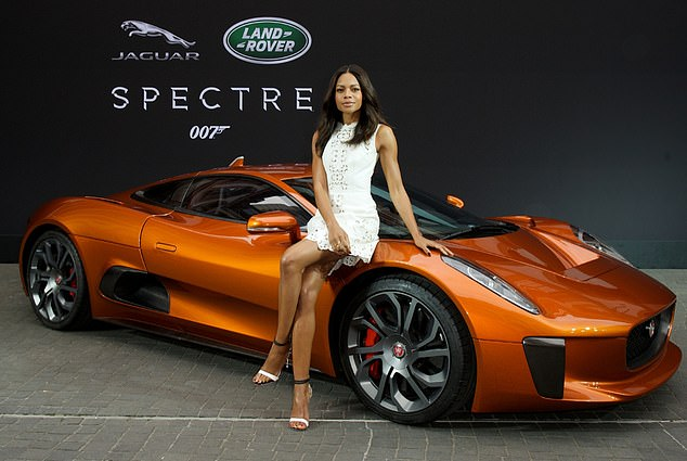 Naomie Harris, who plays Miss Moneypenny, with the electric Jaguar C-X75 supercar which appeared in the 007 movie Spectre