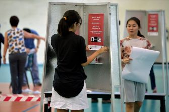 Singapore votes, with 2.46 million at the polls, Government ...