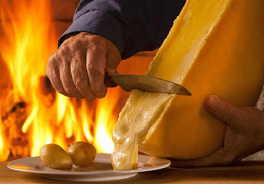 10 Must-Visit Christmas Markets Around the World for Foodies Zurich christkindlimarkt Raclette Swiss Melted Cheese