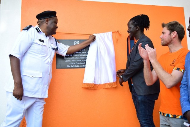 Dr. Steven Kasiima, the Director Traffic Police (L) officially opening the Academy.