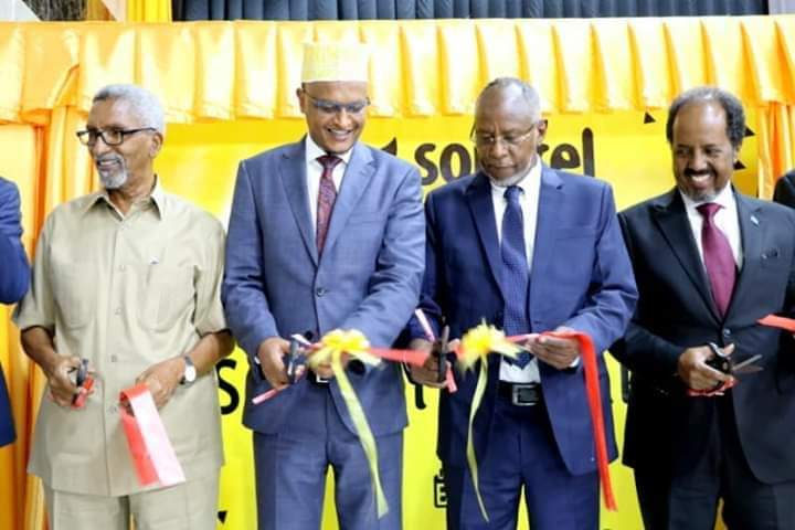 Officials of Dahabshiil Group and invited guests cut the ribbon to commemorate the official launch of 3G and 4G mobile and internet network, and eDahab mobile payment services for Somali customers and the floating of Somtel Shares to the public in Mogadishu