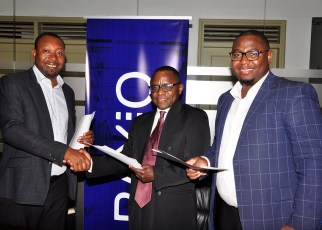 Raxio General Manager James Byaruhanga and Paul Nalikka, Director, Hamilton Telecom, flanked by Ahura Vianne Allan the CFO, signed for their respective organisations, at Raxio's offices at Rwenzori Towers, Nakasero, Kampala