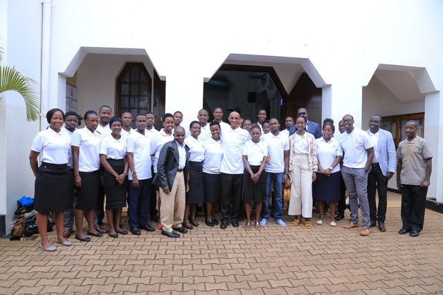 A group photo of staff of Heritage Coffee Company Limited outside All Saints Cathedral Kampala on 23 April 2019