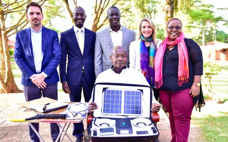 President Yoweri Kaguta Museveni carrying some a package of some of the products manufactured by Fonix industry as he posed for a photograph with a team from the Fonix industry shortly after their meeting at State House Nakasero on Saturday 30th March 2019.