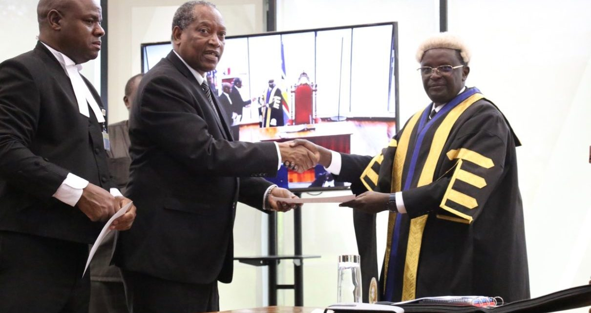 The Minister for Foreign Affairs and East African Co-operation, United Republic of Tanzania, Prof Palamagamba Kabudi takes the oath of Allegiance administered by EALA Clerk Assistant, Victor Manzi