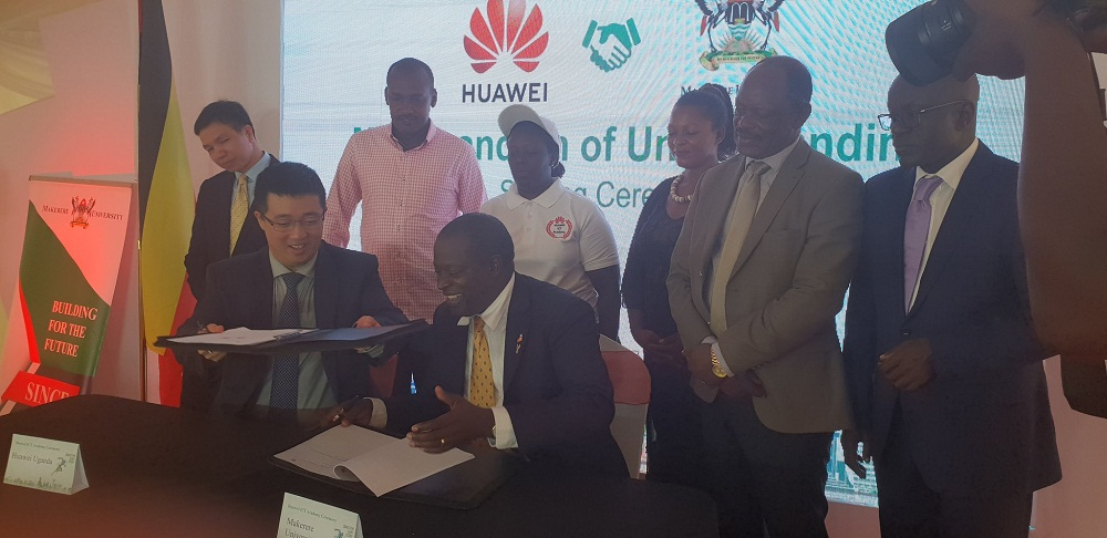 Uganda's Minister for ICT and National Guidance Frank Tumwebaze (In Pink Shirt) witnessing the signing of a Memorandum of Understanding between Huawei Uganda and Makerere University to establish the first ICT Academy.