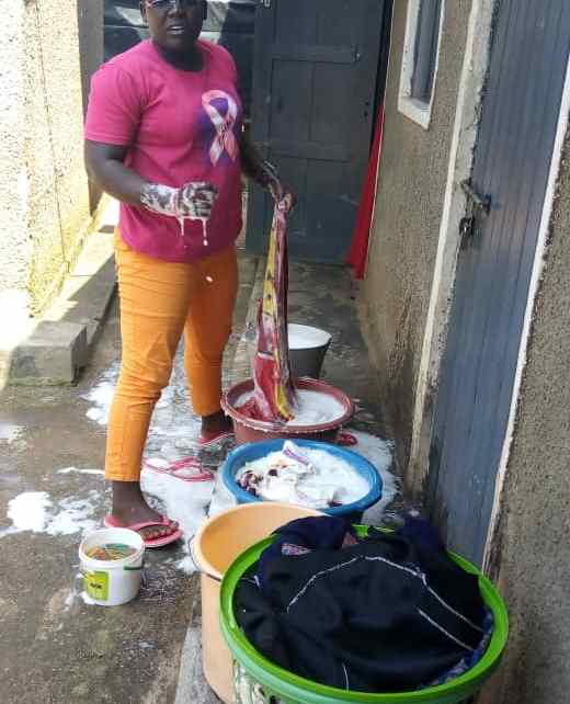 Akello is able to pay for her tuition with money earned from doing laundry