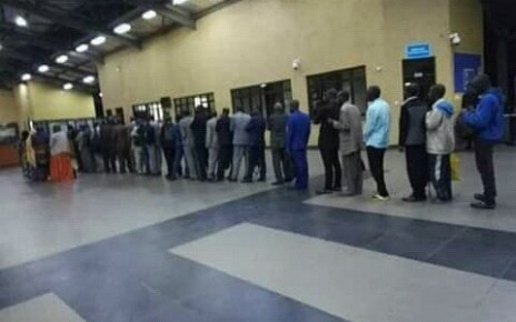 Rwandans lining up at immigration before deportation.