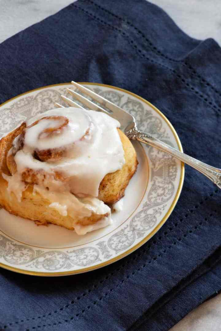 One of The Pioneer Woman's Cinnamon Roll on a plate