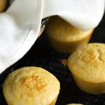 Spoon Bread Muffins next to a basket