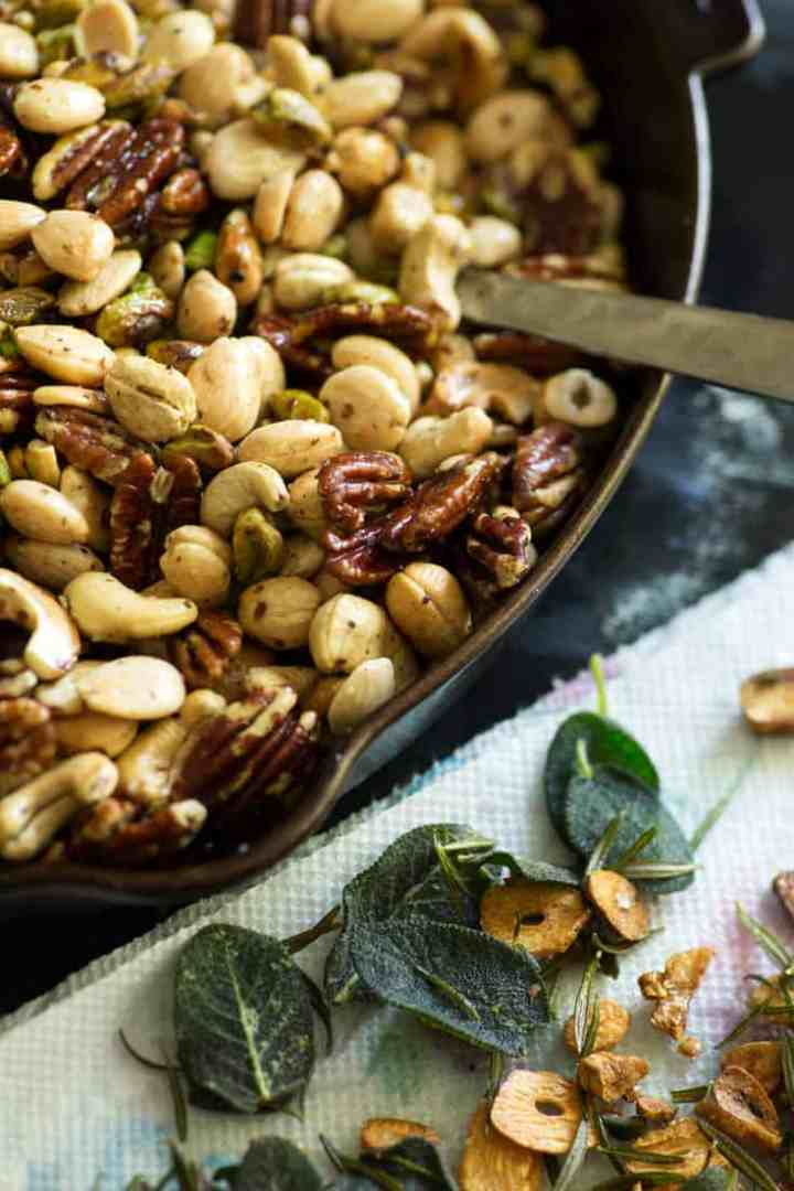 Roasted nuts with sage in a skillet