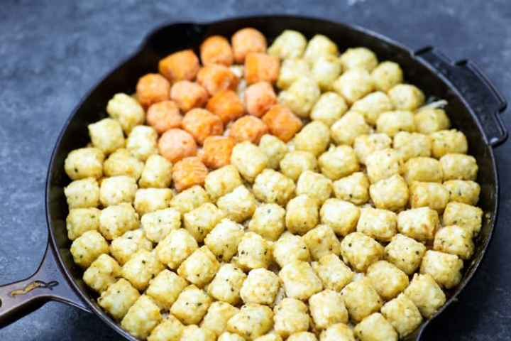 A skillet of Tater Tot Casserole before it has baked