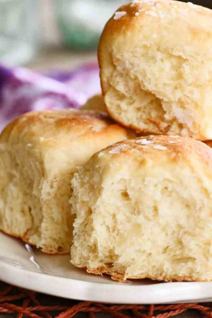 A plate of mashed potato dinner rolls