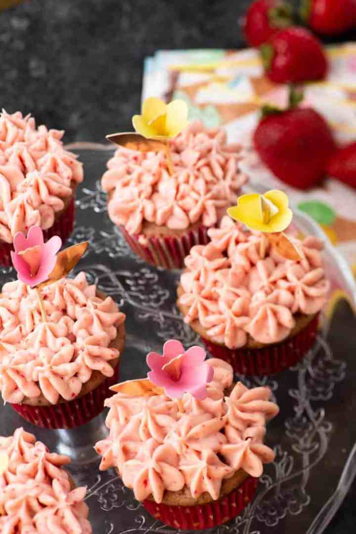 A platter of Strawberry Filled Cupcakes with pink icing