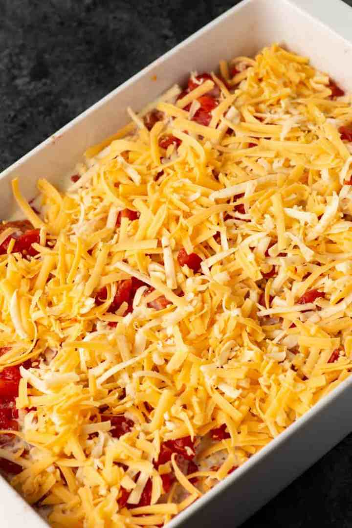 A baking dish of queso chicken
