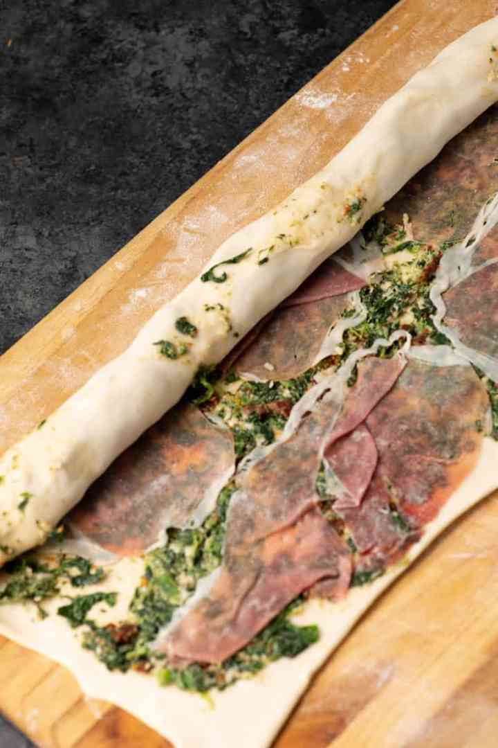Puff pastry covered with spinach and proscuitto