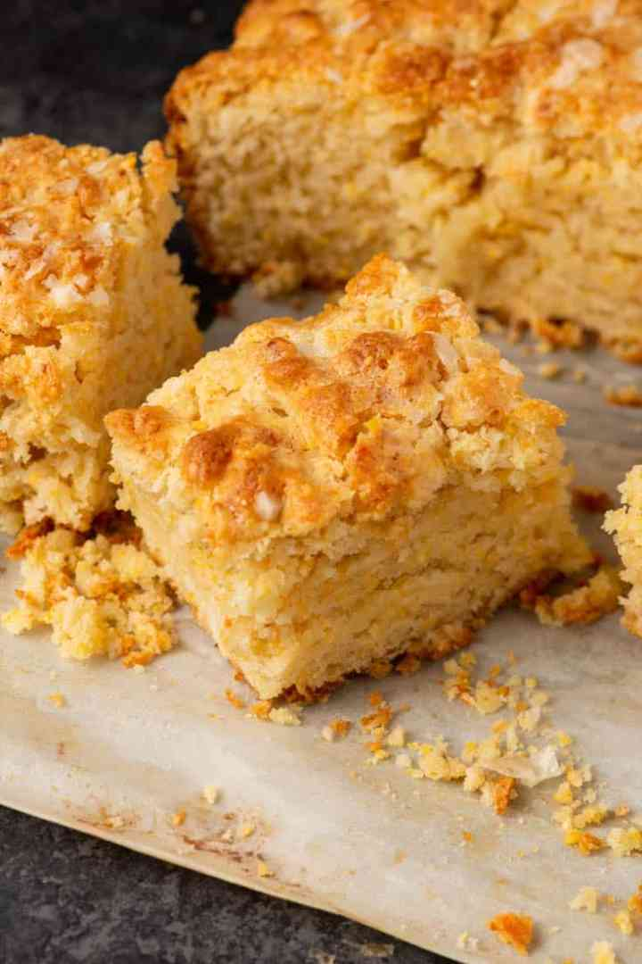 A batch of cornmeal biscuits on parchment paper