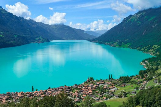 Switzerland 's clear blue waters with houses and green trees