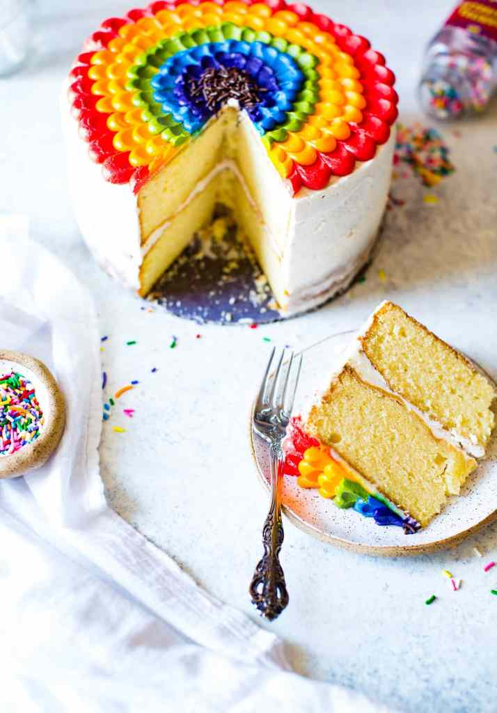 vanilla almond cake with rainbow petal pattern sliced on a plate