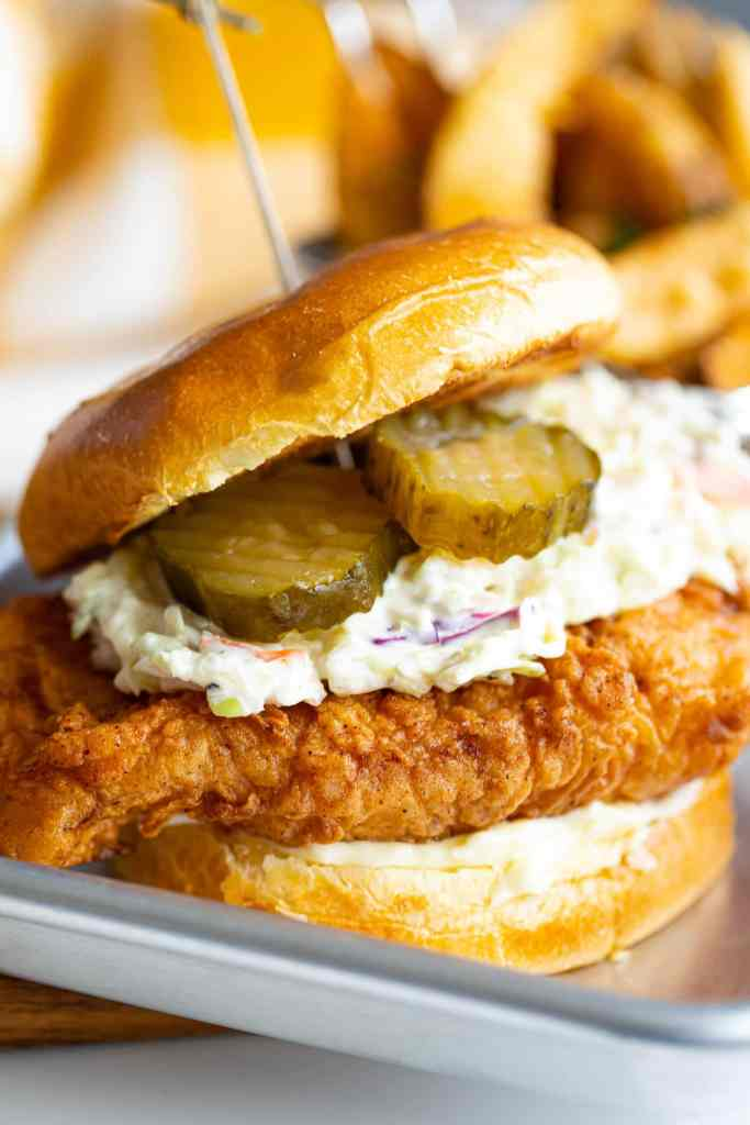 close up shot of fried chicken sandwich on a small tray