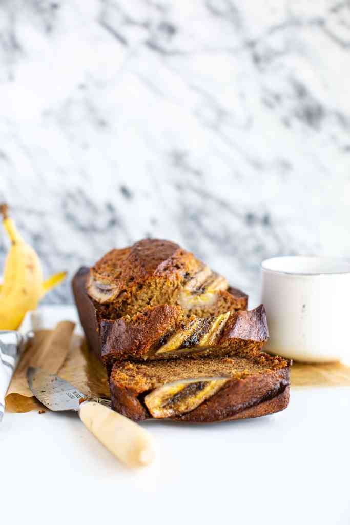 banana bread on brown parchment paper