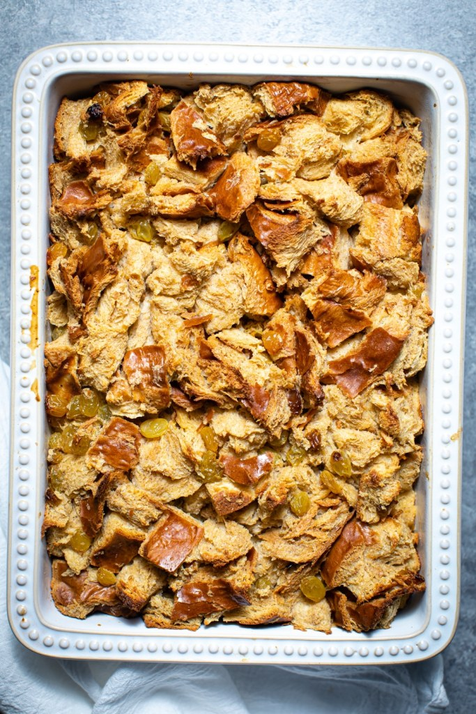 challah bread pudding in white baking dish