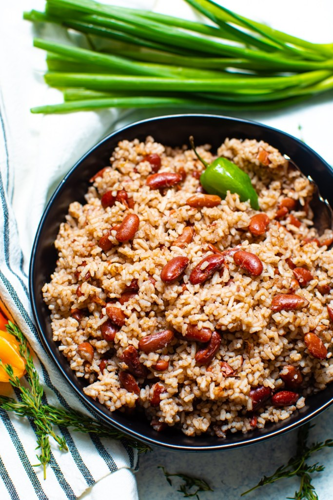 rice and peas in black bowl with scallions