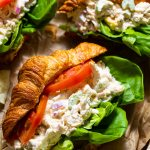 close up of southern chicken salad in croissant with lettuce and tomato
