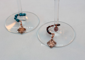 These custom wine charms were made for a couple's wedding! They chose the colors & and the snowflake designs for their December wedding (the wedding date was etched into the back of each snowflake charm).