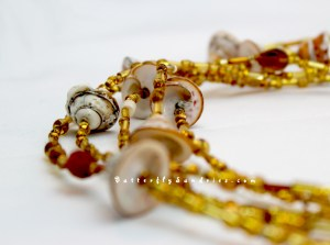I love shells- and these, in particular, always inspire me and capture my imagination. I particularly enjoy the gold highlights and I wanted to enhance them in a design. Complementary beads which emphasized the highlights in long flowing strands remind me of sun-kissed ocean waves... I imagine these shells to be among the treasures of mermaids and Poseidon.