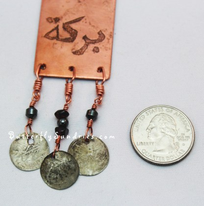 Bless pendant coin perspective on white