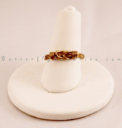 Ring on White Stand