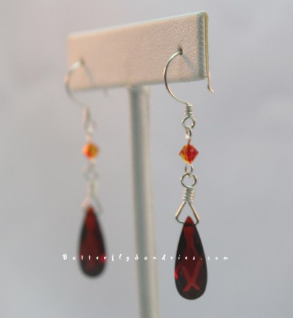 Siam and Fire Opal Angle Hanging on White