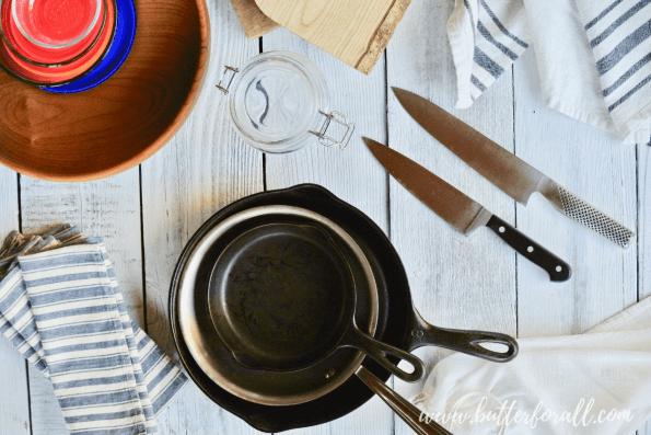 This guide to Sustainable Kitchen practices will help you make green choices in your kitchen. Learn how to ditch plastic and opt for more healthy longterm kitchen products and ideas. #greenhome #eco #kitchen #tools #castiron #stainlessteel #sustainability #green