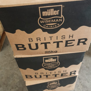 Butter blocks being tempered prior to food production processes