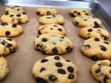 baked chocolate chip cookies in baking pan