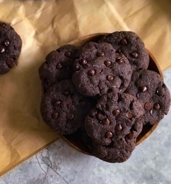 close up view of double chocolate chip cookies in a bowl