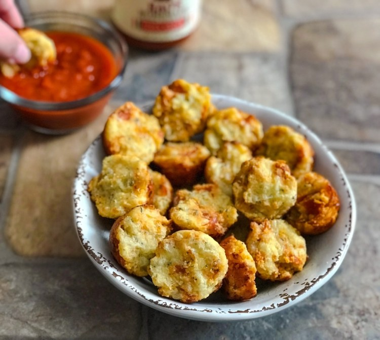 bowl of pizza muffin bites with pizza sauce on the side
