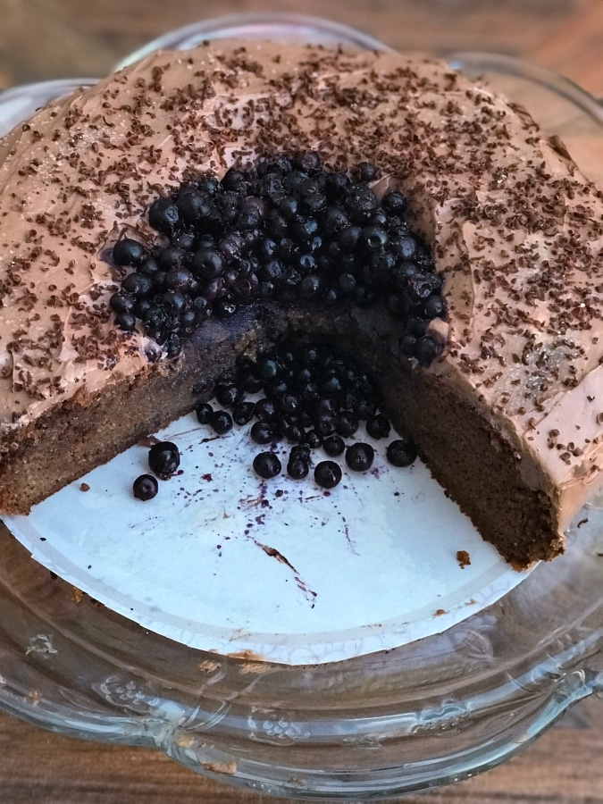 You will love every bite of this delicious chocolate keto cake made with a sweet chocolatey frosting and warm blueberry topping!